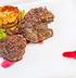 Жареное мясо бобра с драниками под клюквенным соусом